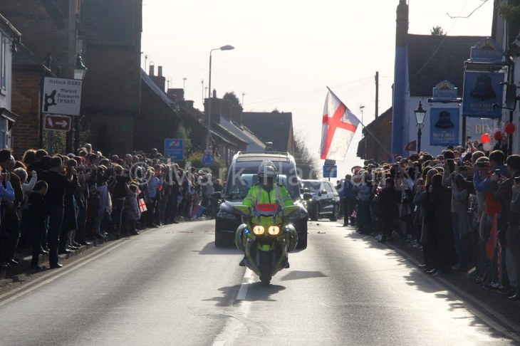 The funeral cortege of King Richard III makes it way through the Leicestershire village of Desford