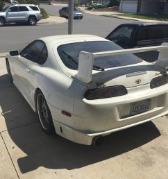 here it is with the older supra counterpart residing in the garage plus a gutted chopped up 89 supra parts car in the driveway  [ 1024 x 768 Pixel ]