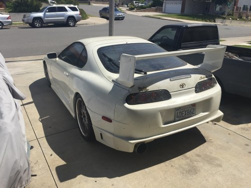 small resolution of here it is with the older supra counterpart residing in the garage plus a gutted chopped up 89 supra parts car in the driveway