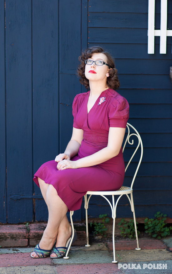 A modernized 1940s look featuring a true vintage '40s dress with embroidered puff sleeves, vintage lucite earrings, modern glasses, and an Erstwilder novelty brooch in the shape of a seahorse