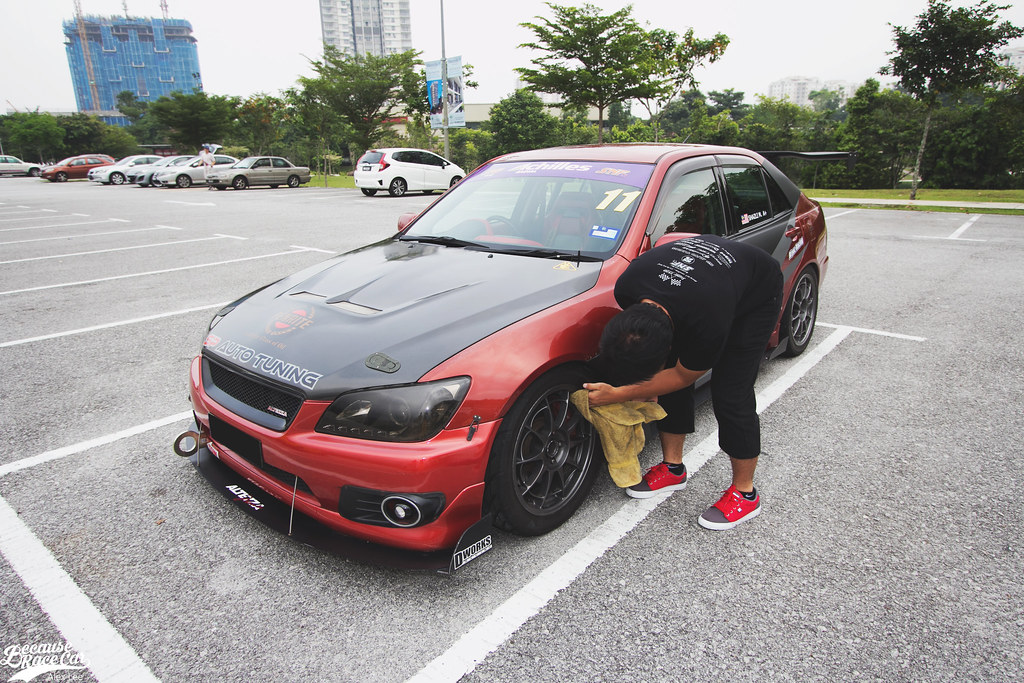 Shazli Wiping Down His Altezza.
