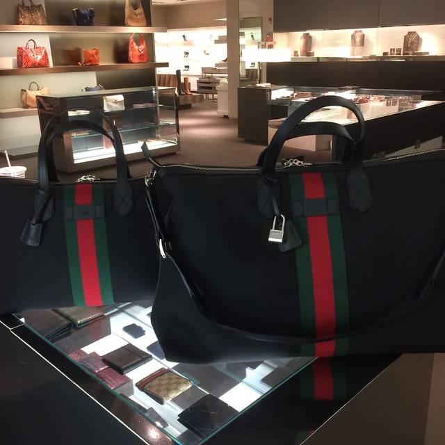 And, a new travel bag, also by Gucci, in signature red and green web stripe