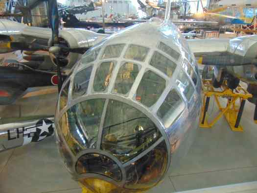 View looking into the lit cockpit of the Enola Gay