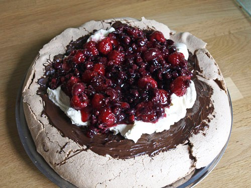 Crisp Chocolate meringue, brushed with chocolate topped with cream and summer berries