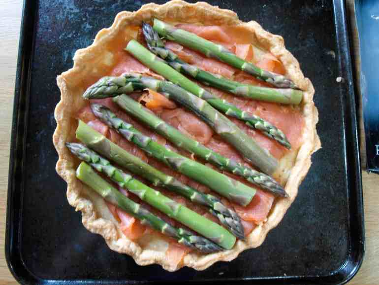 Top the smoked salmon with trimmed asparagus spears