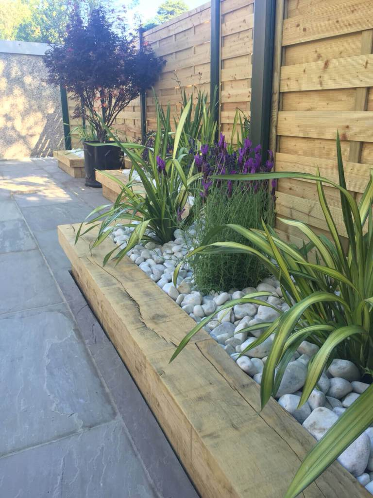 DIY Lawn Edging Ideas For Beautiful Landscaping: Wood Framed Low-Water Garden in Stone