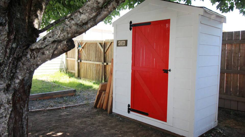 Small White Shed with a Red Door