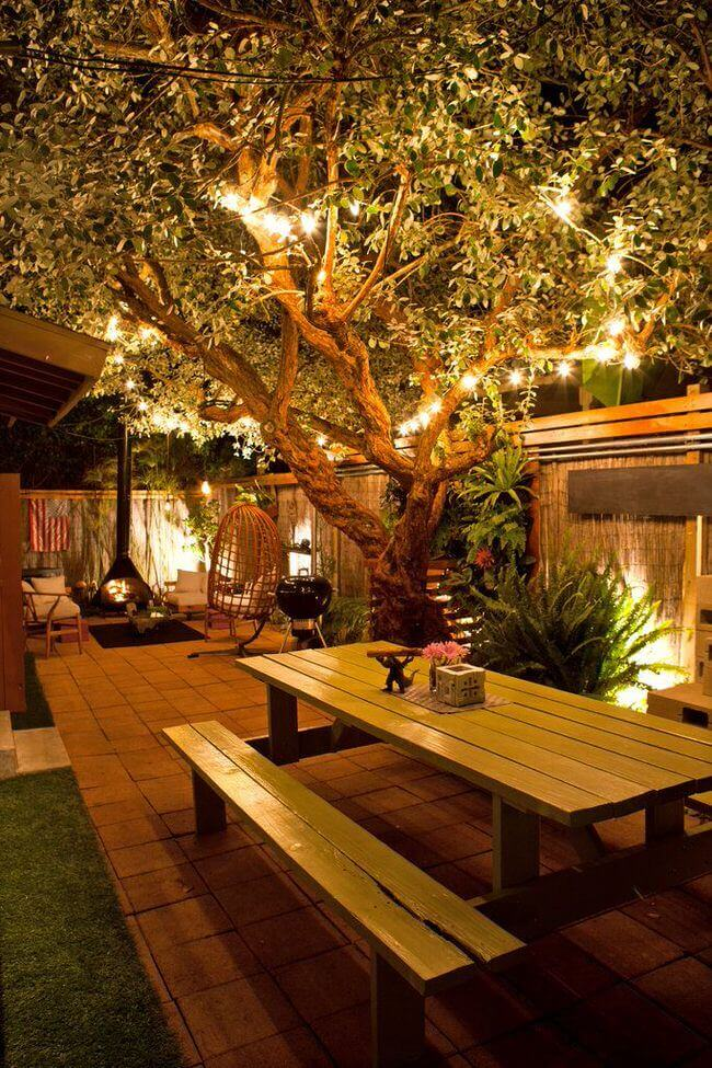 Outdoor Seating Under Tree String Lights