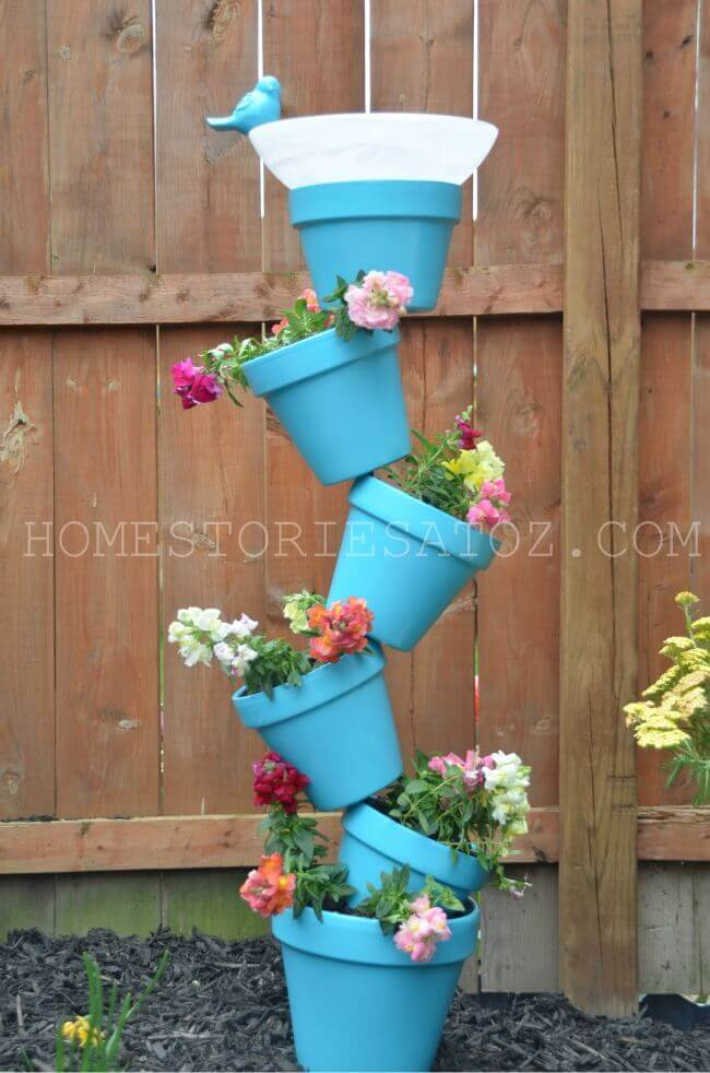 Tilted Flower Pot Arrangement with Bird Bath