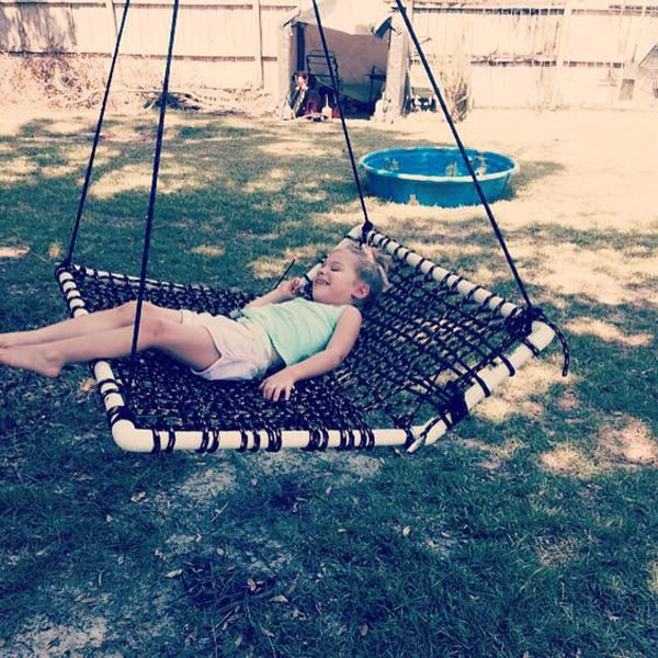 Enjoy cozy outdoor time with this swing made with weaved rope and pvc tubes