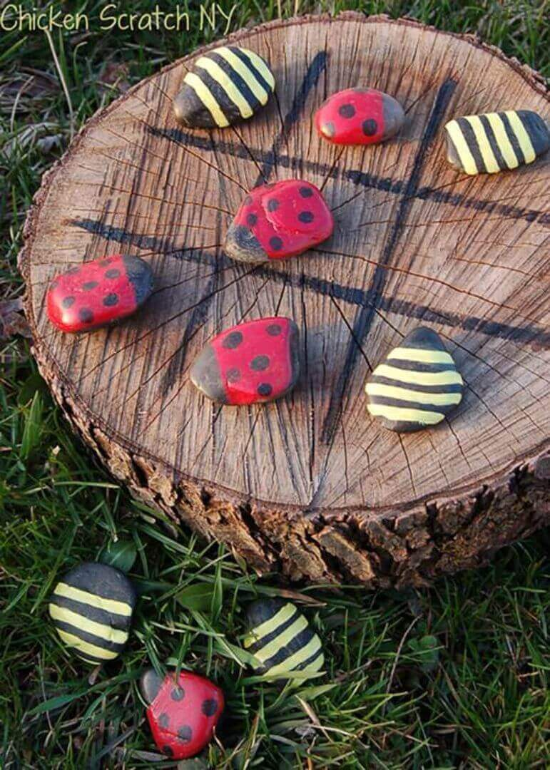 A Tic-Tac-Toe Board with Ladybugs and Bumble Bees
