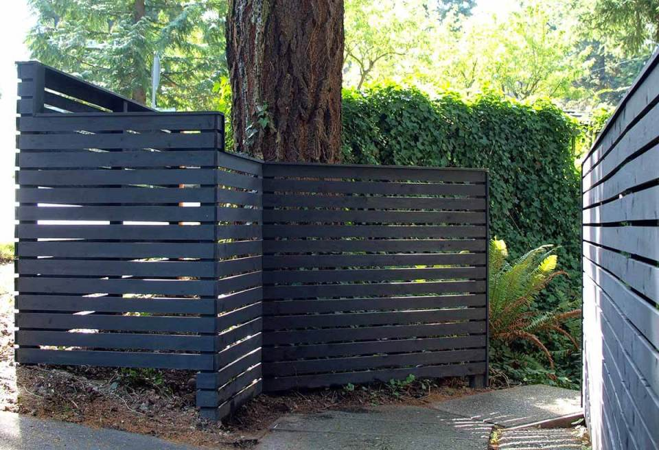 DIY Fence Ideas: Darkly Painted Wooden Garden Fence