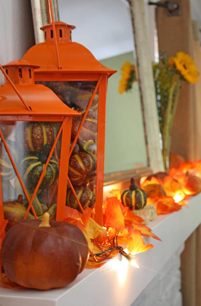 Orange Glow and Lanterns Light this Mantel | Fall Mantel Decorating Ideas For Halloween