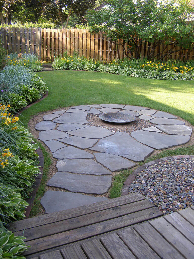 Simplistic Stone Path with a Firepit Center | Awesome Firepit Area Ideas For Your Outdoor Activities