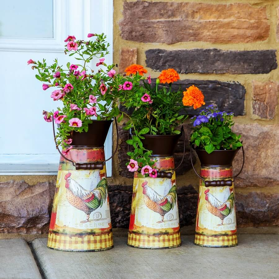 Vintage Garden Decor Ideas: Rustic Decorated Metal Pitcher Planters