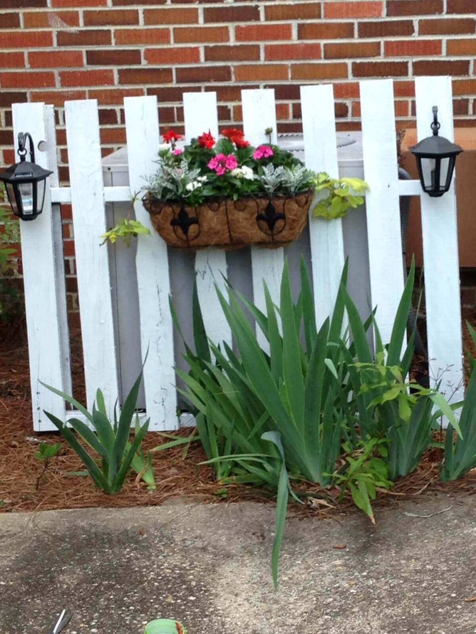 Pretty Picket Fence Screens Unsightly AC Unit | Outdoor Eyesore Hiding Ideas