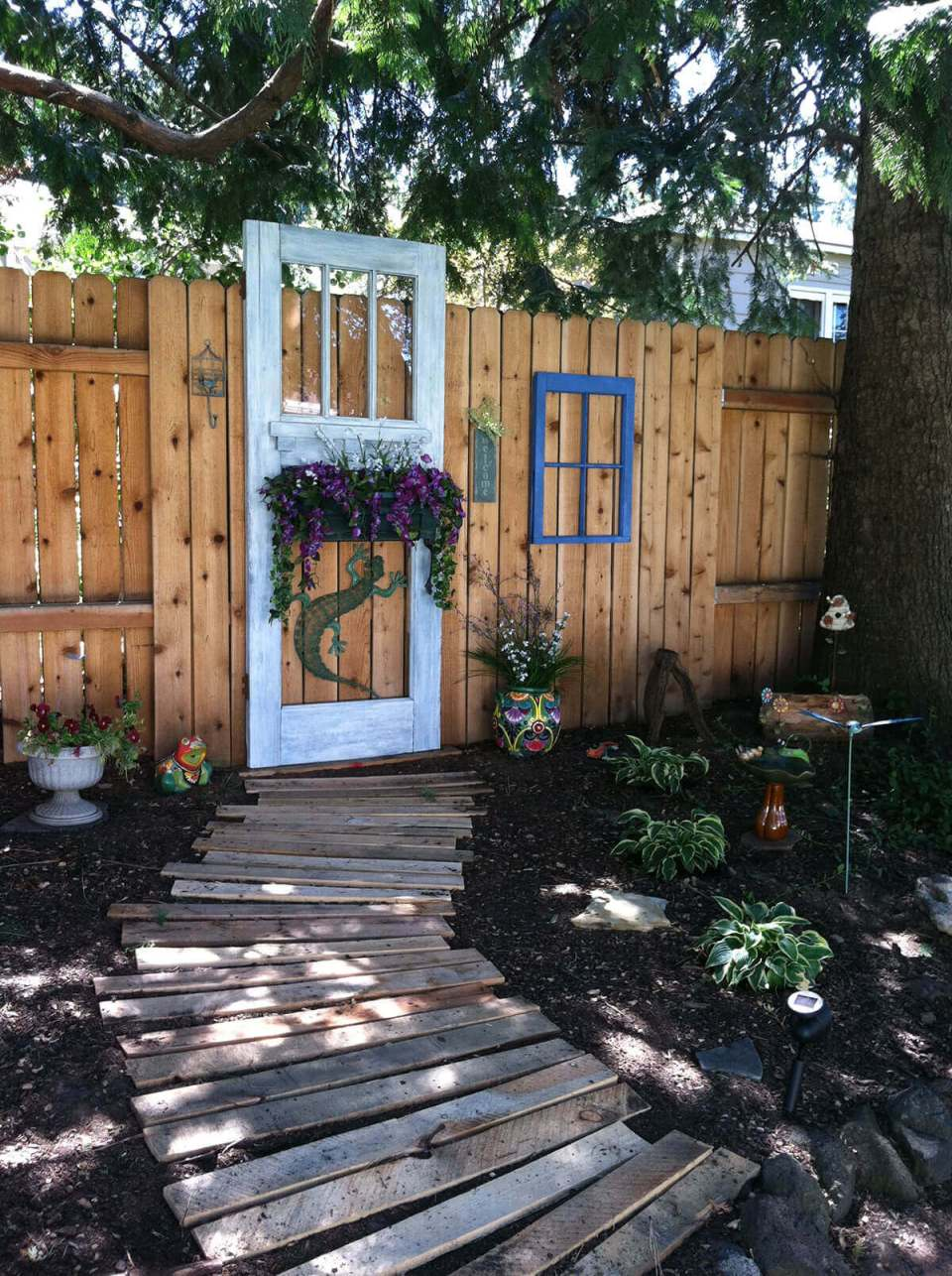 Old Door Hanging on the Fence | Creative Repurposed Old Door Ideas & Projects For Your Backyard