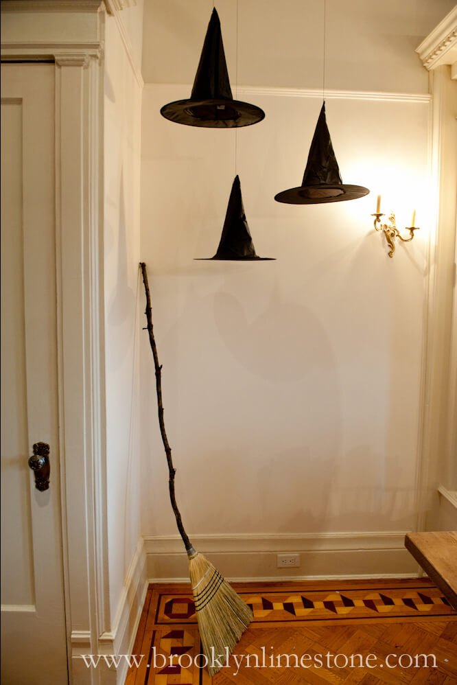 Hanging Hats Conjure Up Ghosts | DIY Indoor Halloween Decorating Ideas