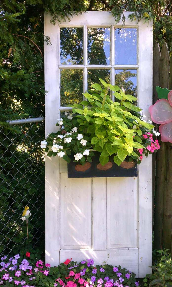 Standing Door with Blooming Flower Box | Creative Repurposed Old Door Ideas & Projects For Your Backyard