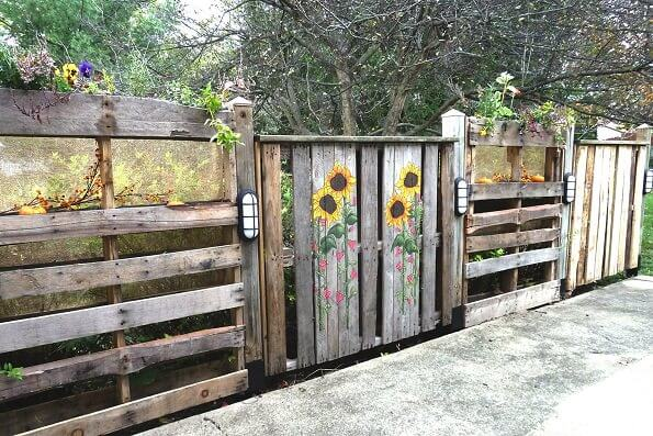 DIY Fence Ideas: Hand Painted Recycled Wooden Pallet Fence