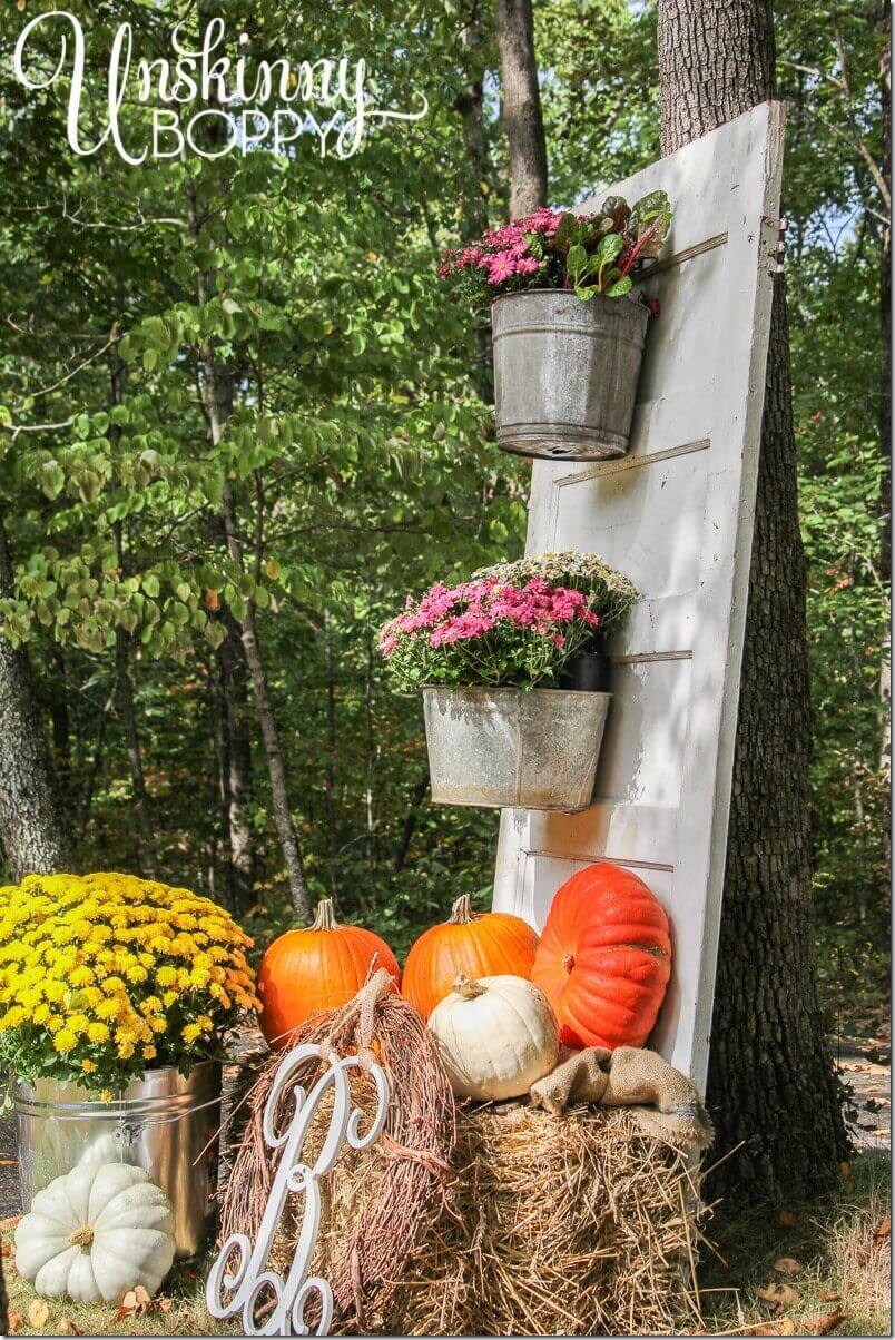 Fall Display with Mums and Pumpkins | Creative Repurposed Old Door Ideas & Projects For Your Backyard