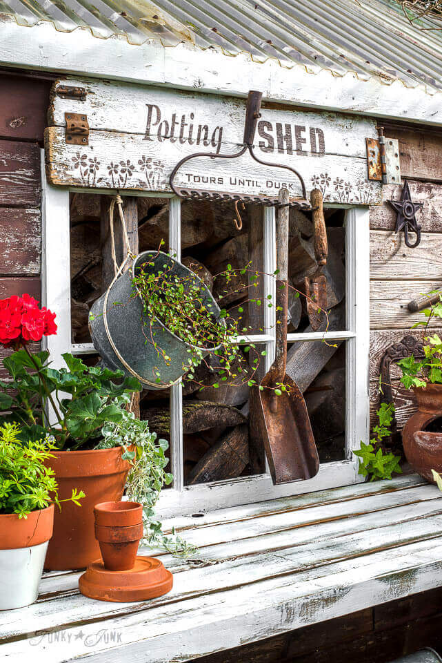 Potting Bench with Fun Sign and Old Rake   Funny DIY Garden Sign Ideas