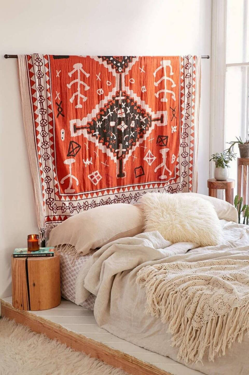 Minimal Bedroom With Leafy Decor and a Patterned Rug Above the Bed   Bohemian Chic Interior Design Ideas   FarmFoodFamily.com