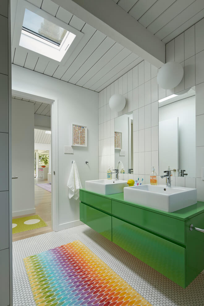 Green vanity and colorful mat | Kids Bathroom Décor Tips: Decorating Ideas for a Child's Bathroom