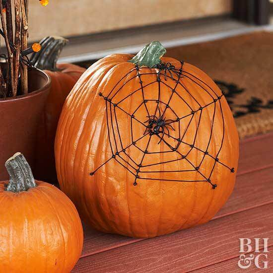 Spider Web Pumpkin | No-Carve Pumpkin Decorating Ideas For This Halloween