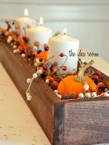 Cushion candles, pumpkins, and berry garlands with Spanish moss | DIY Fall Candle Decoration Ideas - Farmfoodfamily.com