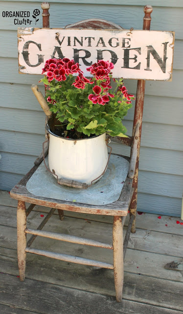 Vintage Sign on a Reclaimed Chair | Creative Upcycled DIY Chair Planter Ideas For Your Garden