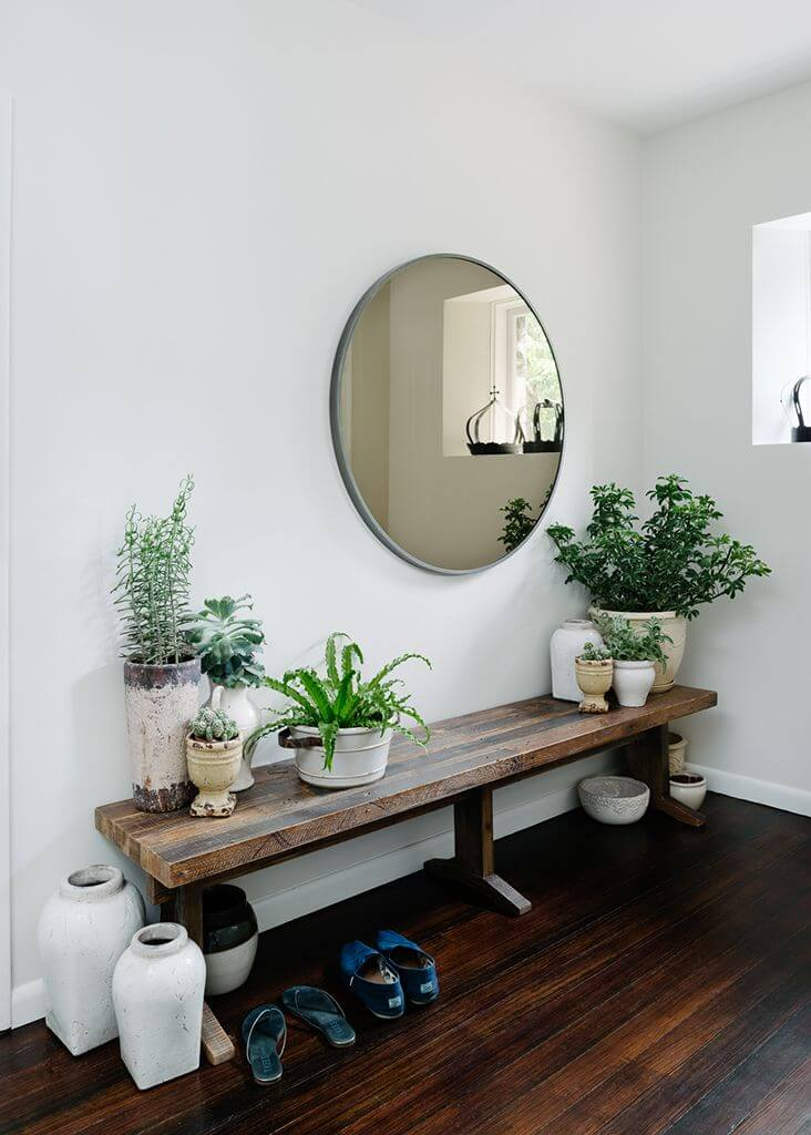 Round mirror above a bench with planters | Best Entryway Mirror Decor Ideas