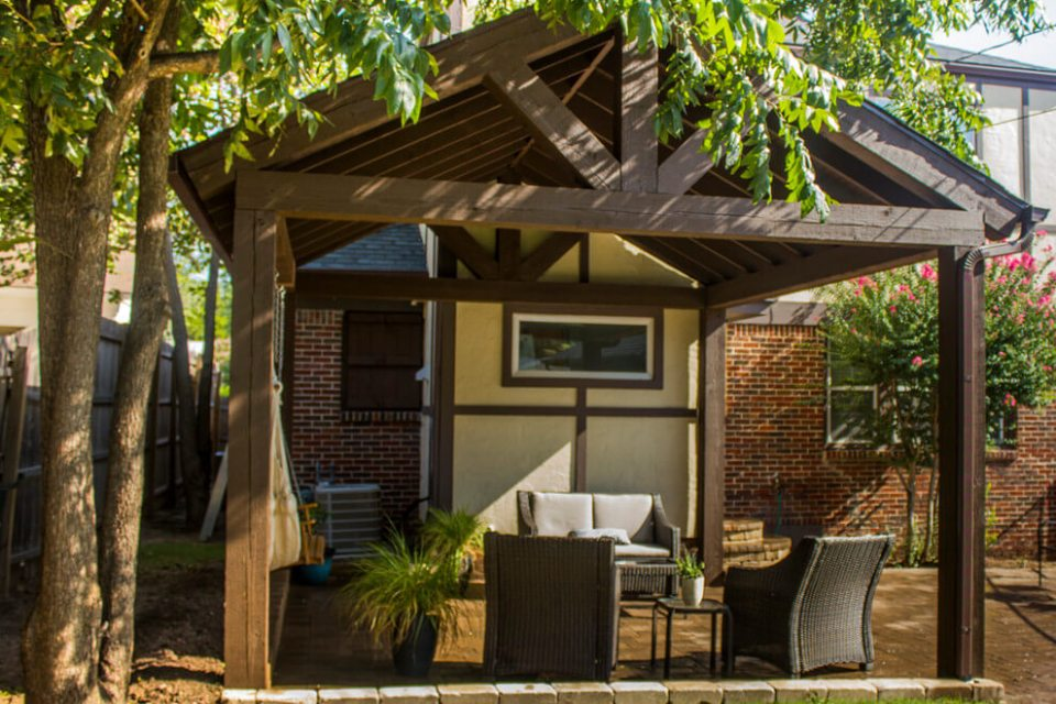 Wooden Backyard Pavilion with a Brick Paver Patio