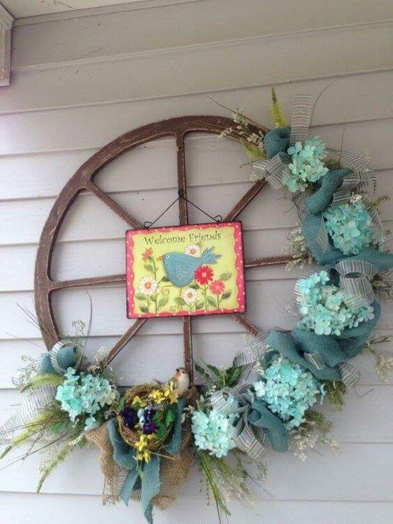 Old Wheel Decorated With Flowers For Easter | Best Easter Porch Decorating Ideas