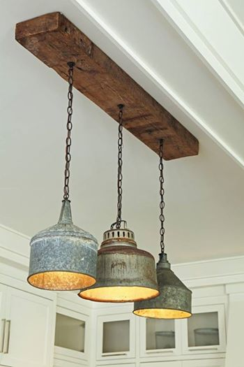 Rustic light fixture is made from old tin funnels | Trending & Vintage Porch Lighting Ideas & Designs | FarmFoodFamily.com