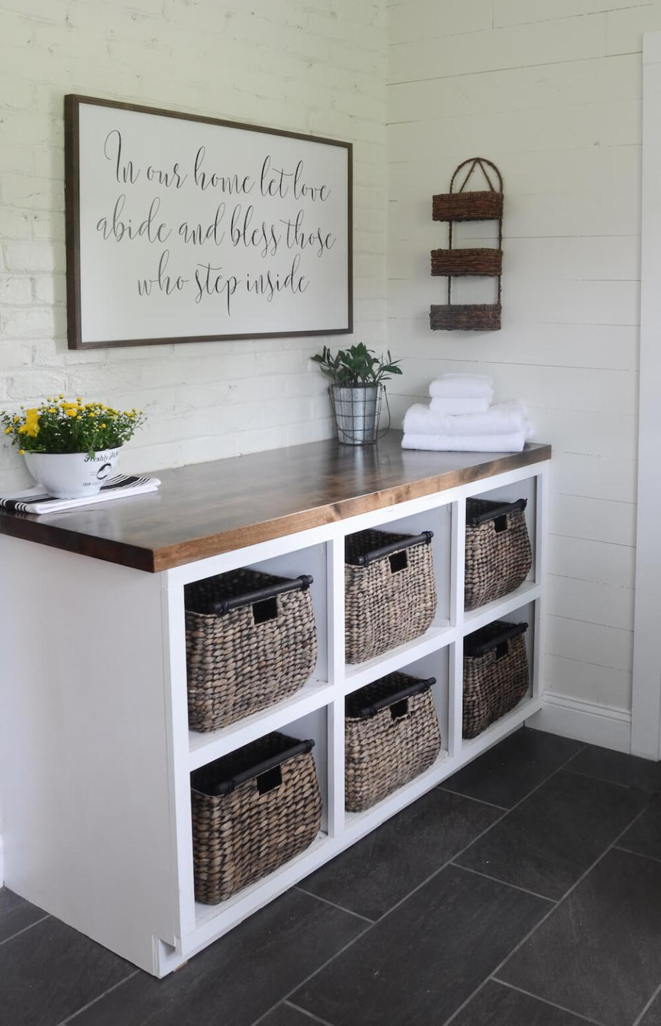 DIY Farmhouse Laundry Room Ideas: Folding station with baskets for each child's laundry