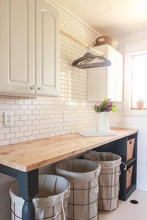 DIY Farmhouse Laundry Room Ideas: Turned table legs painted and wire laundry baskets from old tomato cages