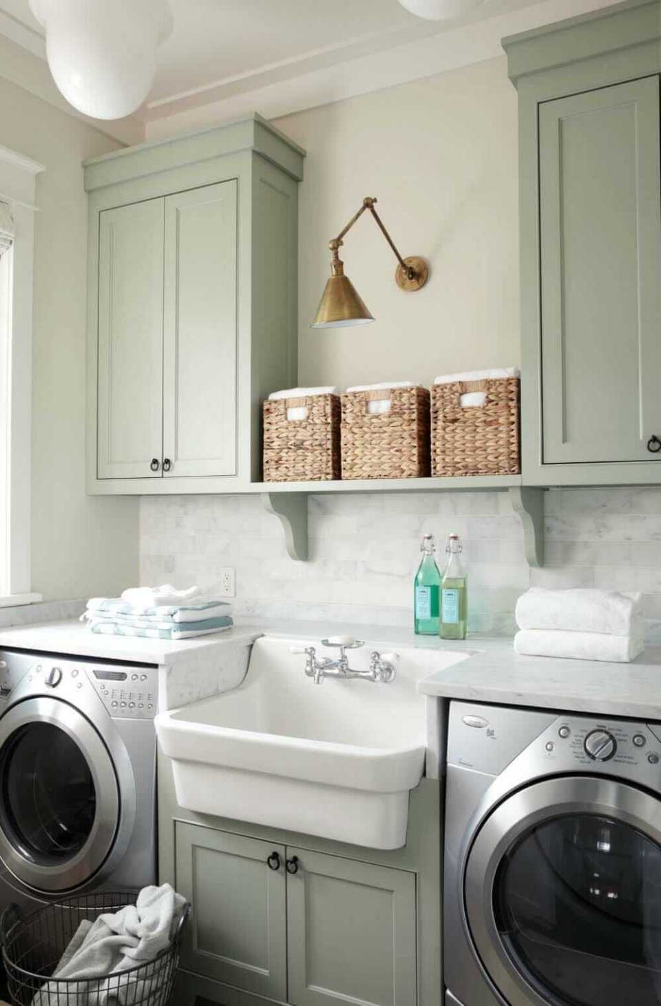 DIY Farmhouse Laundry Room Ideas: Self cabinet above white sink with marble slab countertop