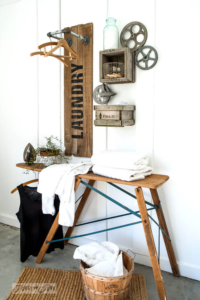 DIY Farmhouse Laundry Room Ideas: Reclaimed wood and pipe LAUNDRY sign hanging station