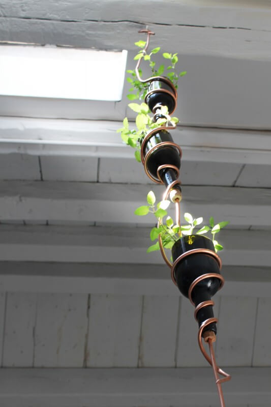 Easy DIY hanging herb garden from wine bottles