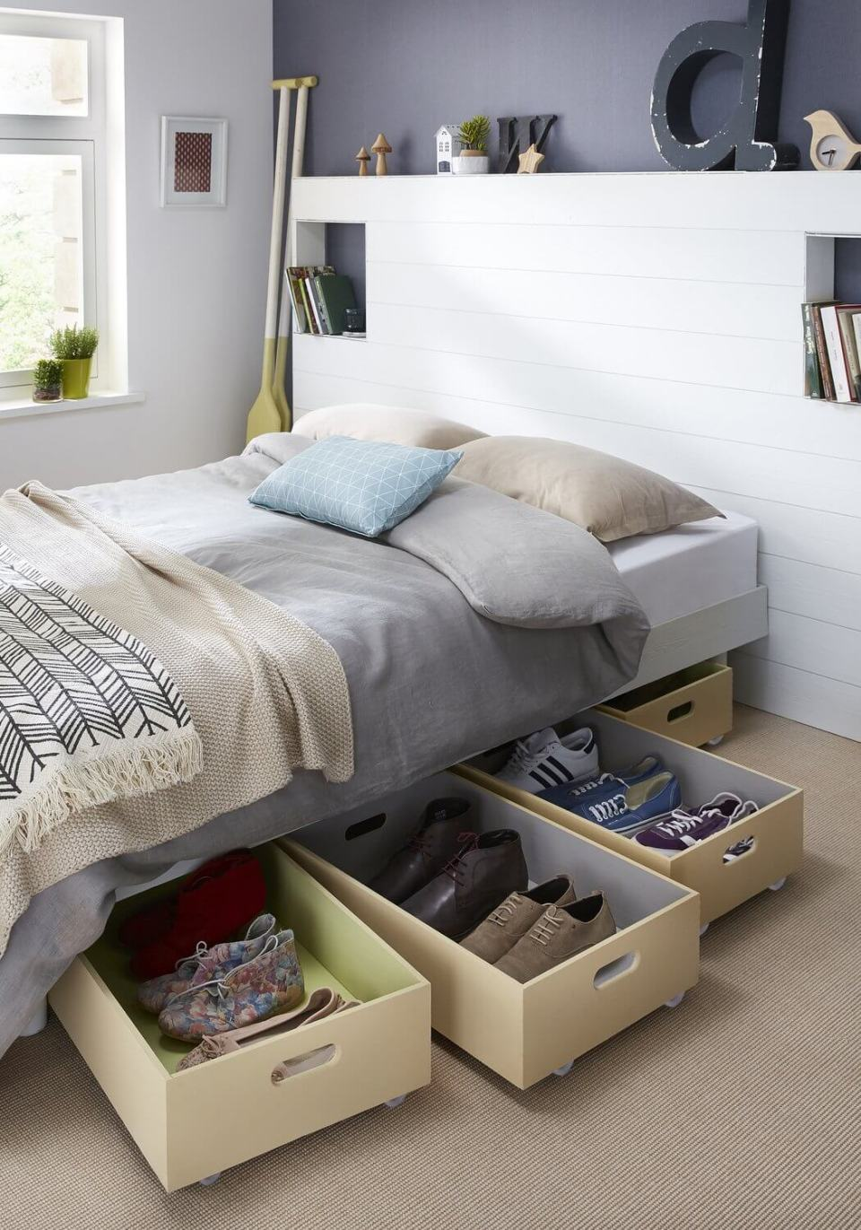 best bedroom organization ideas Wooden boxes mounted on wheels hidden under the bed