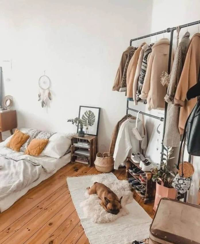 Bedroom for lady with mattress on the floor and wardrobe made of metal tubes