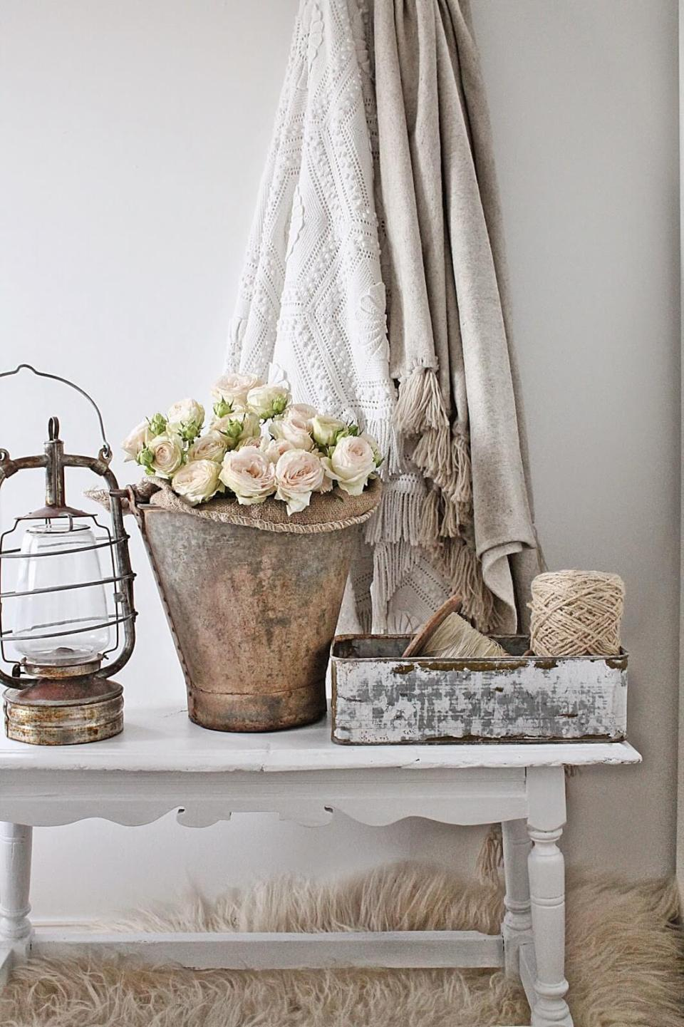 Rustic bucket with roses