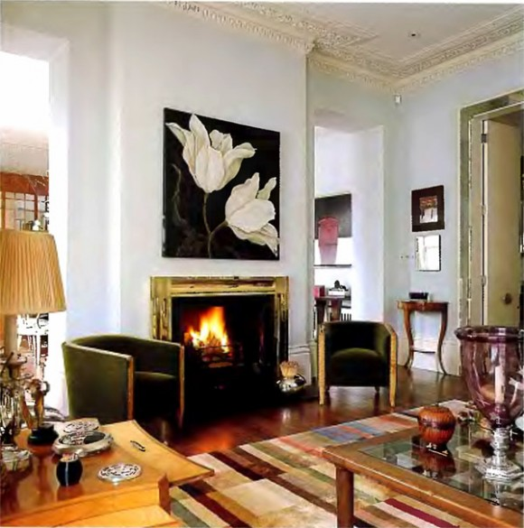Eclectic fireplace design with wall decor