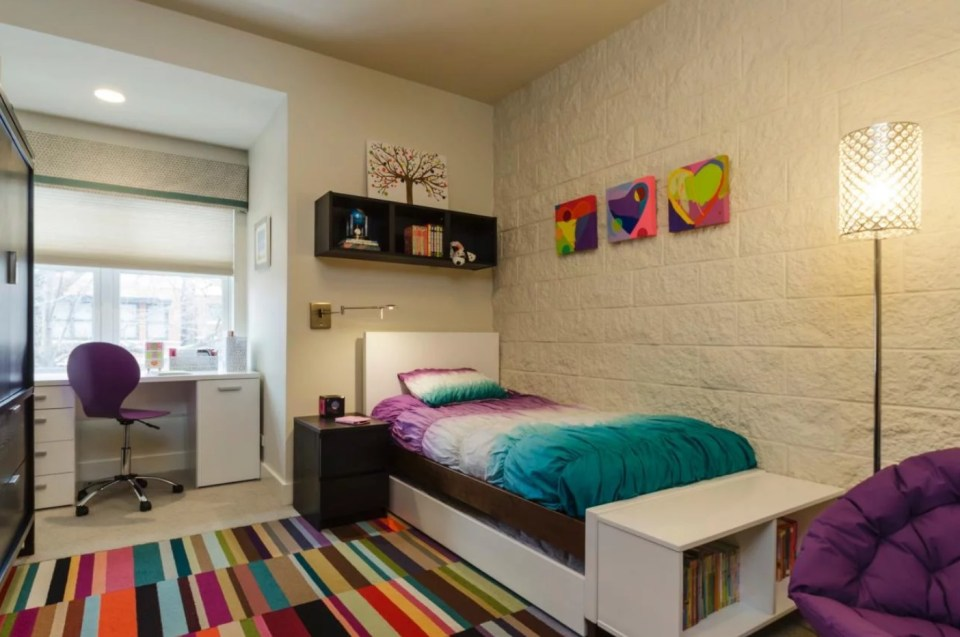 Room with a colorful carpet