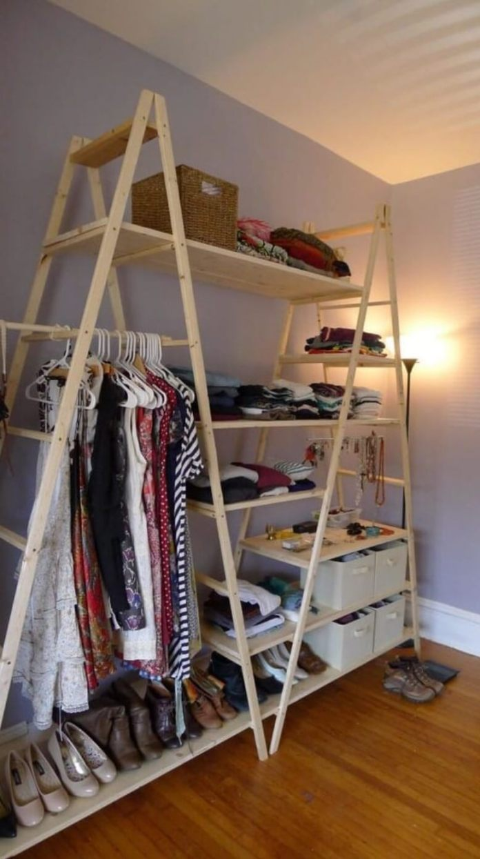 Improvised wardrobe made with wooden stairs and shelves