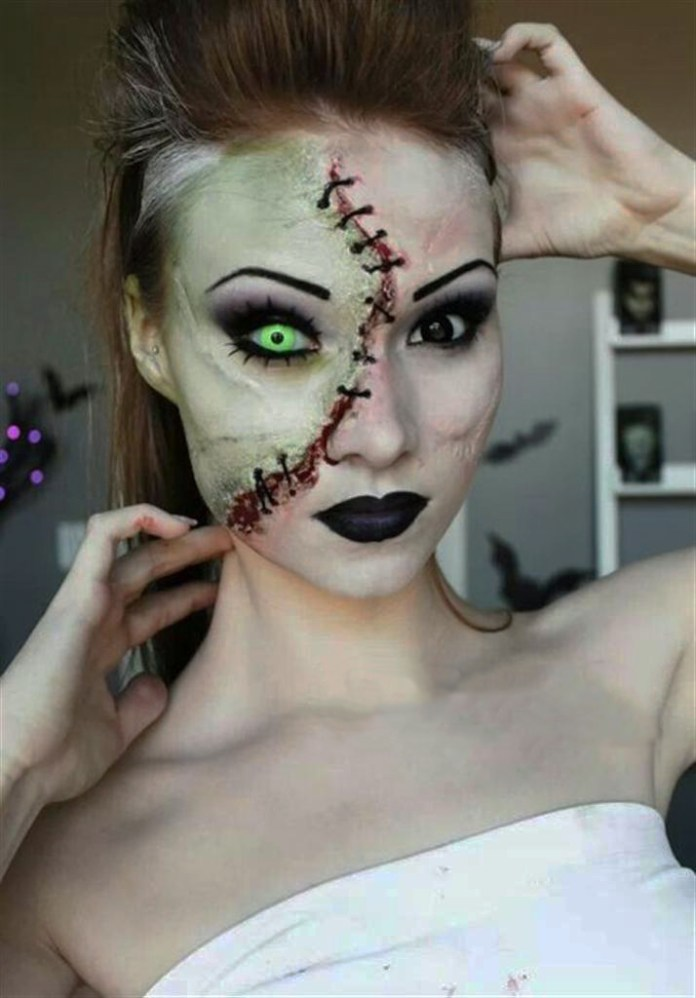 Girl with makeup for halloween as zombie without half of the face