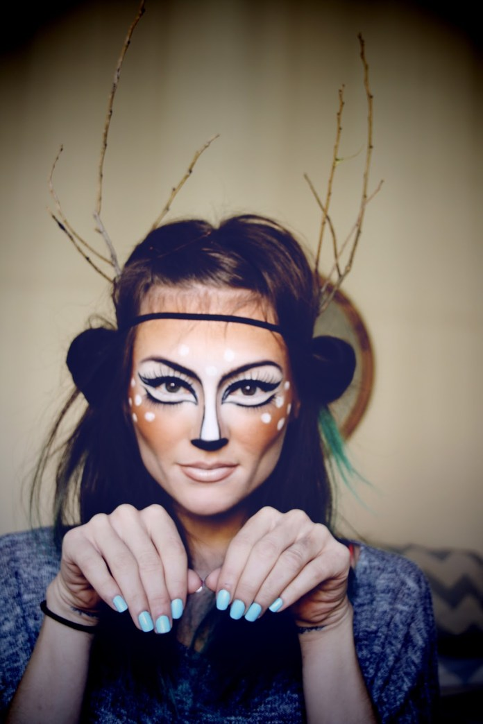 Girl with makeup for halloween as a deer