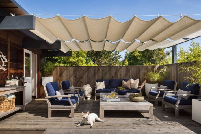 Stain deck with shade sail