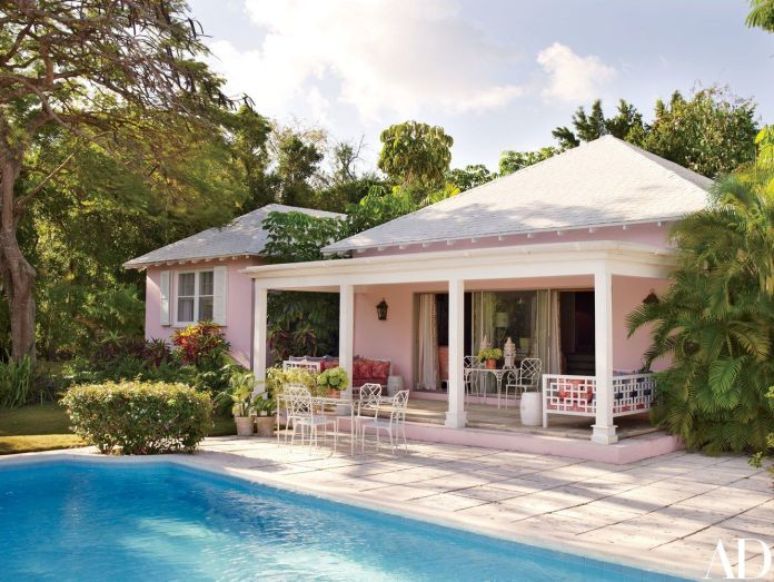 Cottage exterior with pink accents